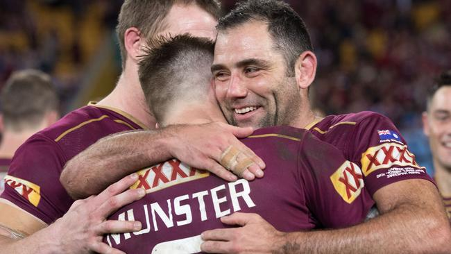 Cameron Munster and Cameron Smith embrace after winning Origin in 2017.