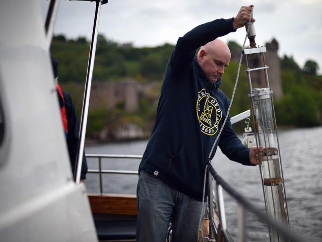 Professor Gemmell takes samples on his boat. Picture: AFP