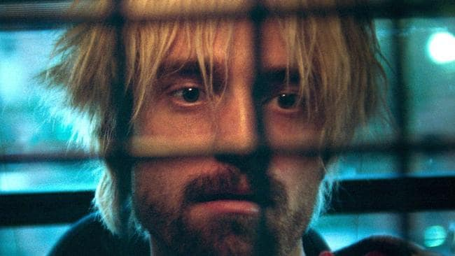 Robert Pattinson looks a little like the late Kurt Cobain after he bleaches his hair midway through Good Time.