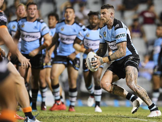 Josh Dugan of the Sharks runs the ball.