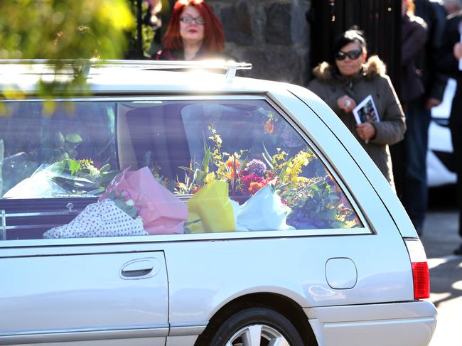 Family and friends of murdered Melbourne comedian Eurydice Dixon are seen during a private funeral service in Brunswick, Melbourne, Thursday, June 21, 2018.