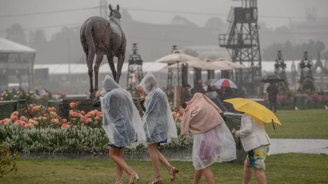 Punters make their way past the statue of three-time Melbourne Cup winner Makybe Diva, a well known mudlark. icture: Jason Edwards