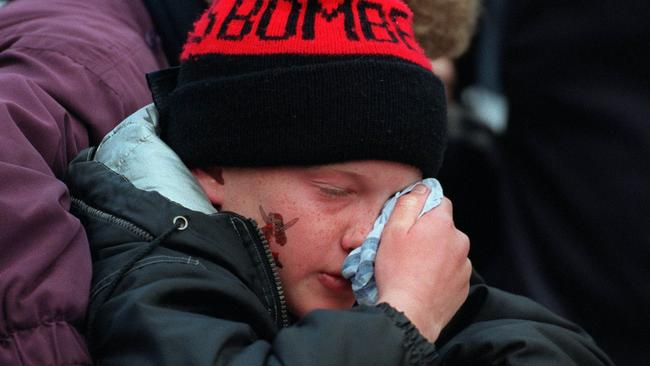 A young Essendon fan can't believe the result. Picture: Michael Dodge