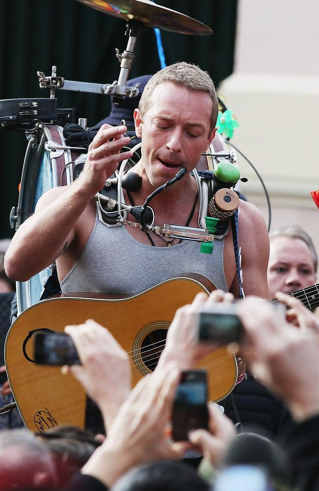 King of King St... Coldplay's Chris Martin films outside Newtown Police station in Sydney on Tuesday. Picture: Getty