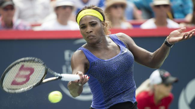 Serena Williams makes a return to Caroline Wozniacki during her three-set Rogers Cup win.