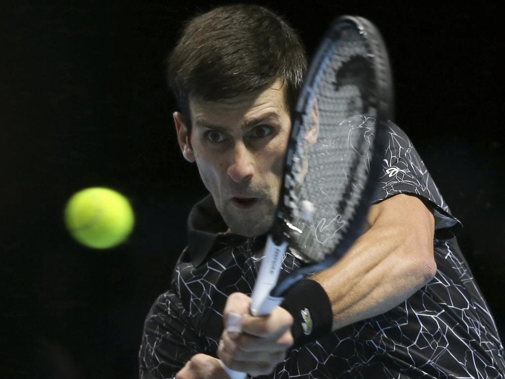 Novak Djokovic, of Serbia, plays a return to Marin Cilic, of Croatia, during their ATP World Tour Finals singles tennis match at the O2 Arena in London, Friday Nov. 16, 2018. (AP Photo/Tim Ireland)