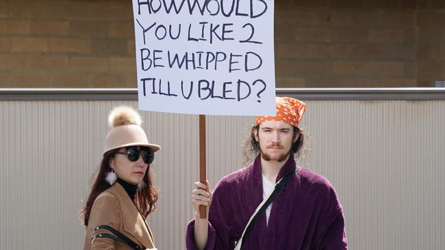 Perry McShane protesting at the Melbourne Cup outside of Flemington. Picture: AAP
