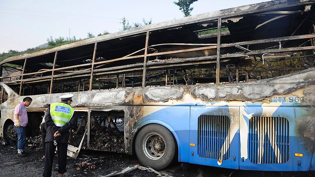 The double-decker sleeper bus rammed into the tanker loaded with highly-flammable methanol on a northern Chinese highway on Sunday. Picture: AP