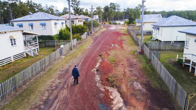 A potential buyer walking down Mills Road at Allies Creek. Picture: Lachie Millard