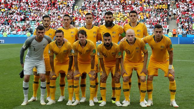 The Socceroos line up for a picture before the game against Peru at the World Cup.