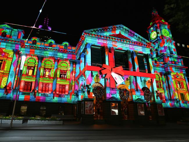 Melbourne Town Hall's traditional facade is transformed into a colourful festive frieze.
