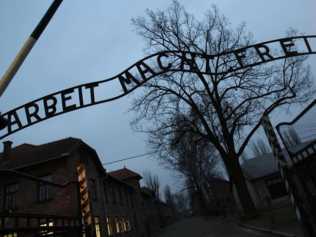 "The entrance to Auschwitz, a former Nazi death camp, in Oswiecim, with the inscription ""Arbeit macht free"" (work brings freedom). Picture: AFP"