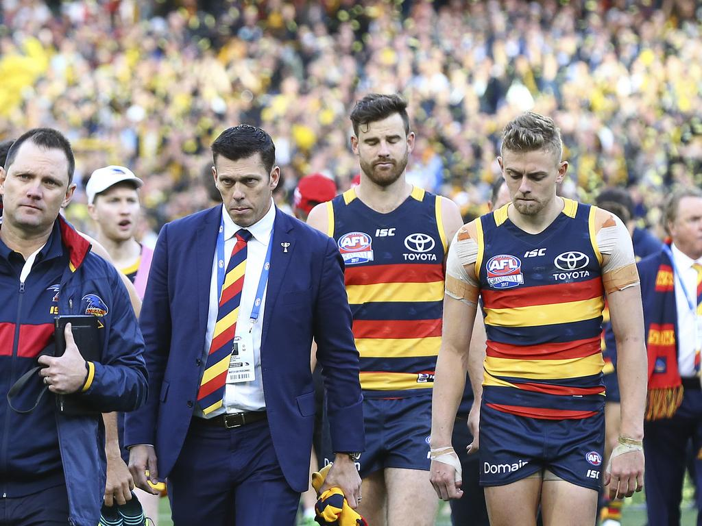 Adelaide Crows CEO Andrew Fagan walks off with the team following the 2017 Grand Final. Photo: Sarah Reed