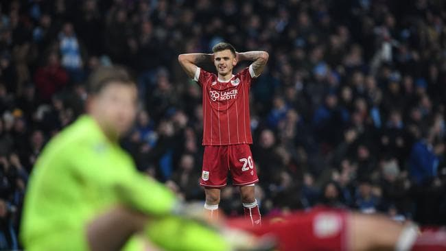 Bristol City's English midfielder Jamie Paterson reacts after they concede