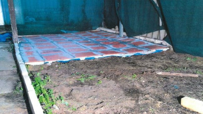 The concrete and tiles that were used to cover the body of Aaron Pajich, from an exhibit to the murder trial. Source: News Corp Australia