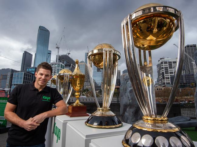 Australian captain Tim Paine with the five World Cup trophies.