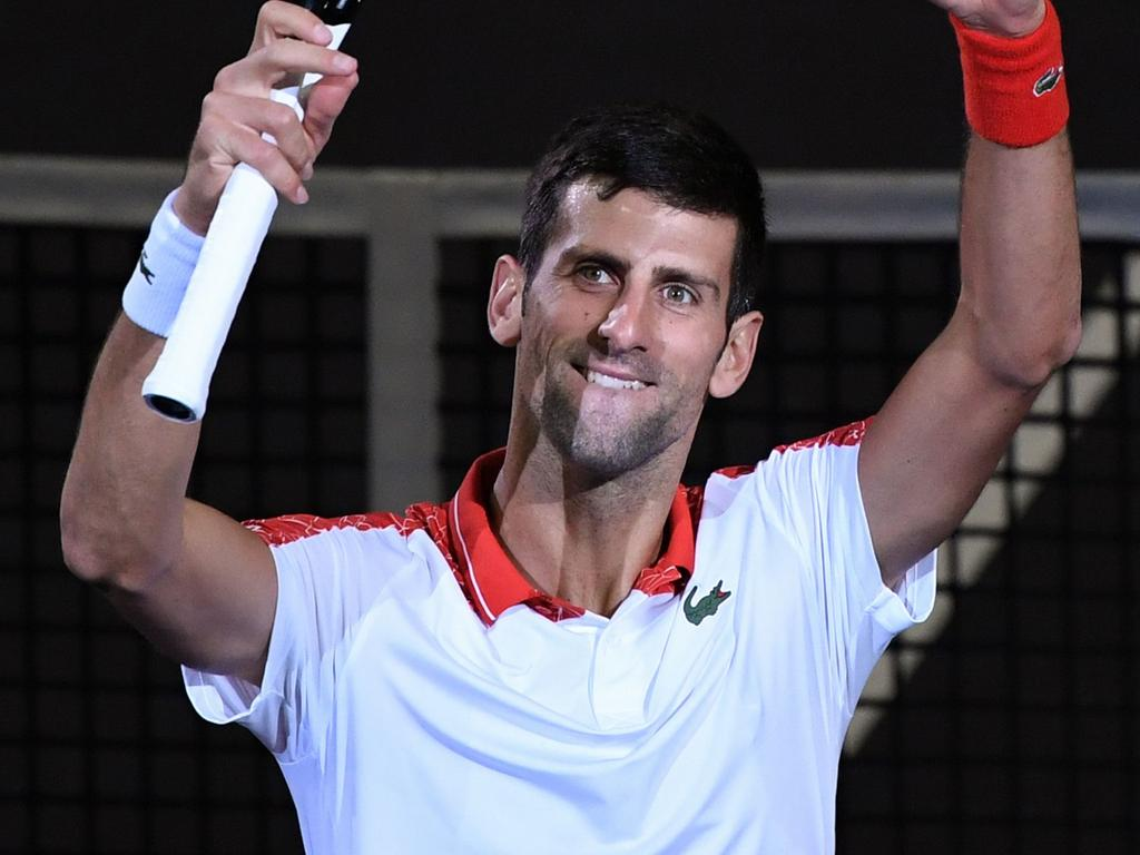 Serbia's Novak Djokovic celebrates beating Croatia's Borna Coric in their men's final singles match at the Shanghai Masters tennis tournament in Shanghai on October 14, 2018. (Photo by WANG Zhao / AFP)