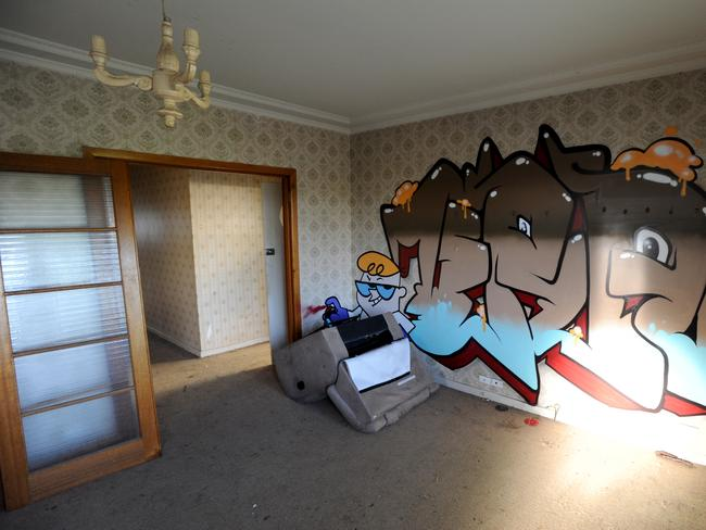 Grafitti covers walls and windows of the squalid house where the young man accused of Aiia Maasarwe's murder was living. Picture: Andrew Henshaw.