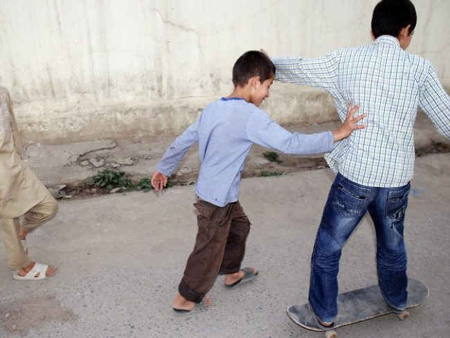 Street skating in Kabul: within minutes of being introduced to skateboarding, these kids are bona fide skaters.