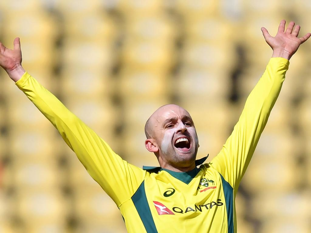 Australian cricketer Nathan Lyon appeals successfully after taking the wicket of Indian batsman Ambati Rayudu during the second one-day international (ODI) cricket match between India and Australia at the Vidarbha Cricket Association Stadium in Nagpur on March 5, 2019. (Photo by PUNIT PARANJPE / AFP) / ----IMAGE RESTRICTED TO EDITORIAL USE - STRICTLY NO COMMERCIAL USE-----