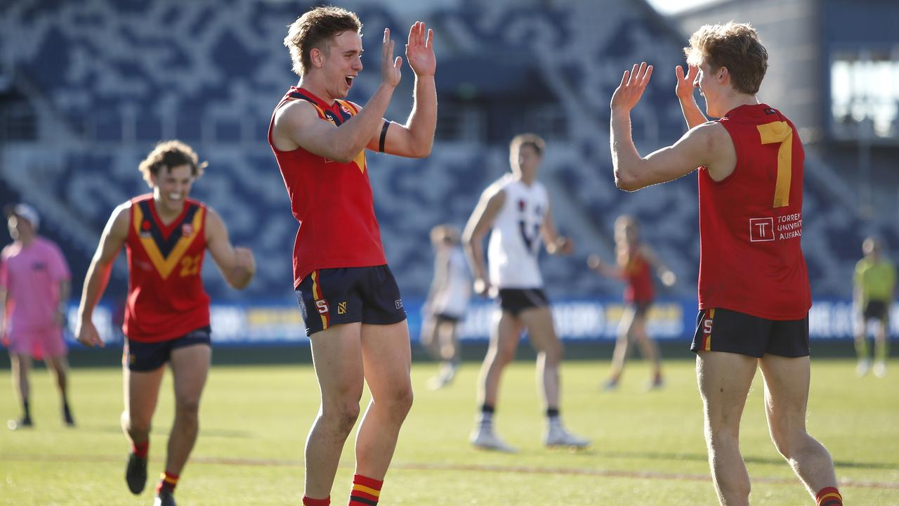 Jackson Mead and Dylan Stephens celebrate a goal. Photo: Dylan Burns/AFL Photos via Getty Images.