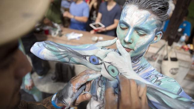Marion La Coguic shows off her cool bodypainting. Photo: John Minchillo.