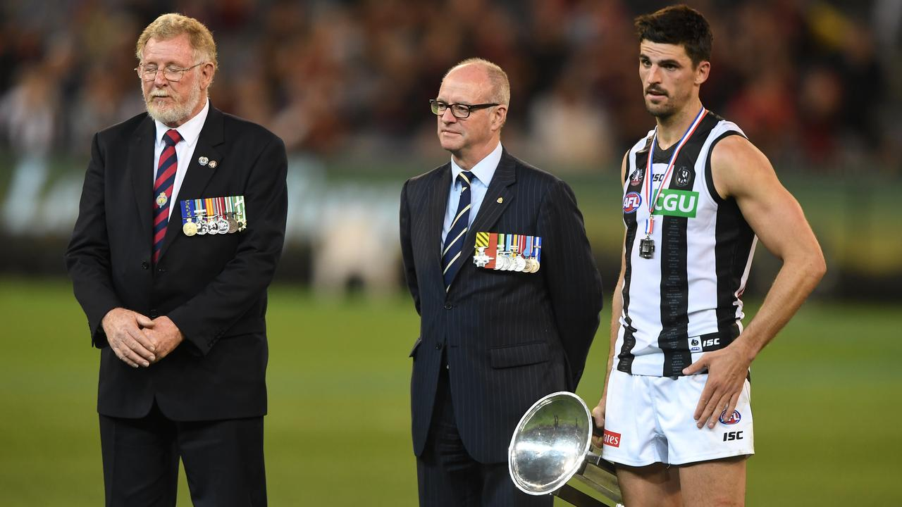 Scott Pendlebury during the Anzac Day Medal ceremony, during which boos rained down from Essendon fans. (AAP Image/Julian Smith)