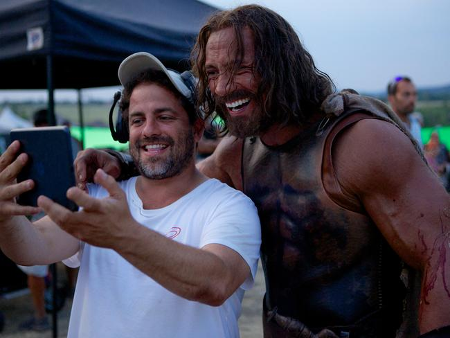 Bret Ratner and Dwayne Johnson having a giggle at Kevin Sorbo's expense.