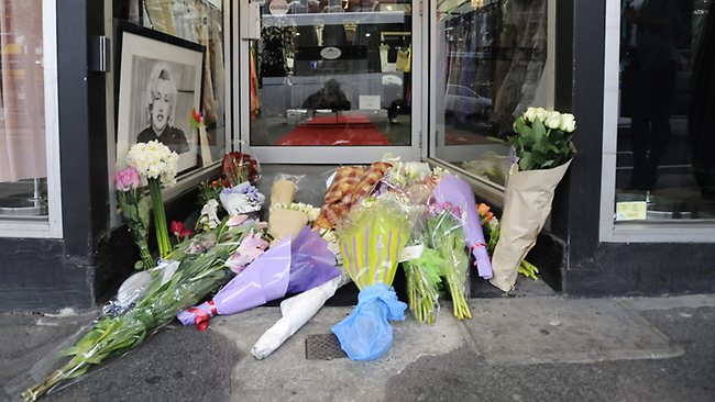 A makeshift shrine to Jill Meagher outside the Duchess Boutique on Sydney Rd, Ms Meagher was captured on the store's CCTV early on Saturday morning. Picture: Robert Mckechnie