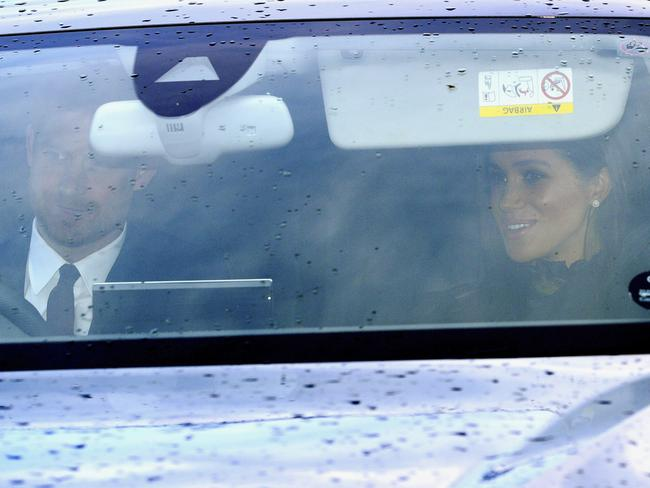 The royal couple en route to the celebrations. Picture: AP
