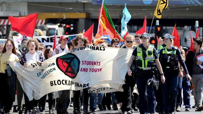 Protestors march through the city in opposition to the International Mining & Resources Conference at the Melbourne Convention Centre. Picture: Andrew Henshaw