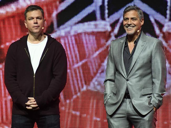 Matt Damon and George Clooney deliver some of their classic banter to eager cinema owners in Las Vegas on Tuesday. Picture: AFP
