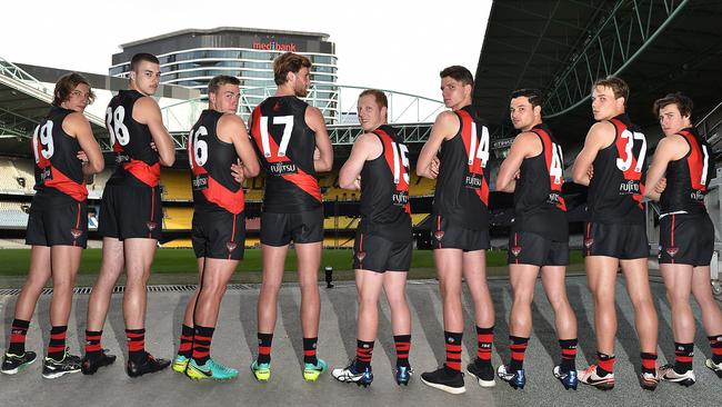 Essendon's recruits and their new numbers. L-R: Kobe Mutch, Sam Draper, Josh Begley, James Stewart, Josh Green, Jordan Ridley, Ben McNeice, Dylan Clarke and Andrew McGrath. Picture: Ellen Smith