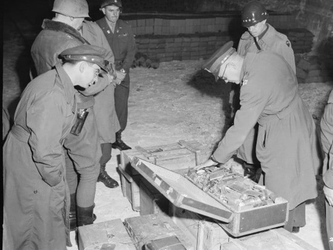 Recovered ... US officers inspect loot recovered from Nazi sympathisers in the last days of World War II. Source: US National Archive