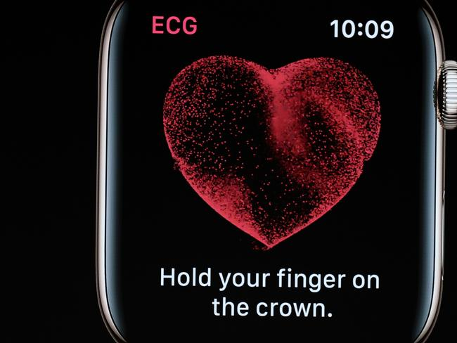 By placing a finger on the crown, the watch could also monitor wearers' heart rhythms in the background and deliver alerts if unusual beats were detected. Picture: AFP