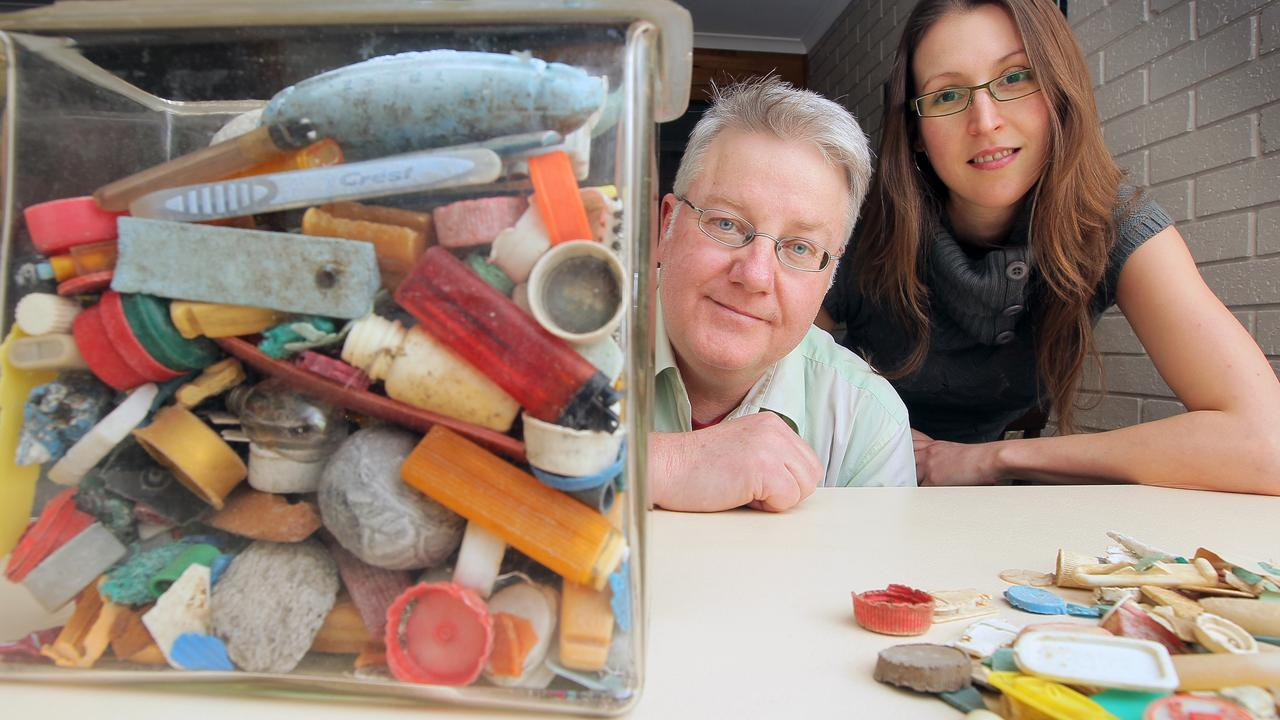 Councillor Bill Harvey and Tasmanian seabird ecologist Dr Jennifer Lavers with a collection of plastics found in dead seabirds.