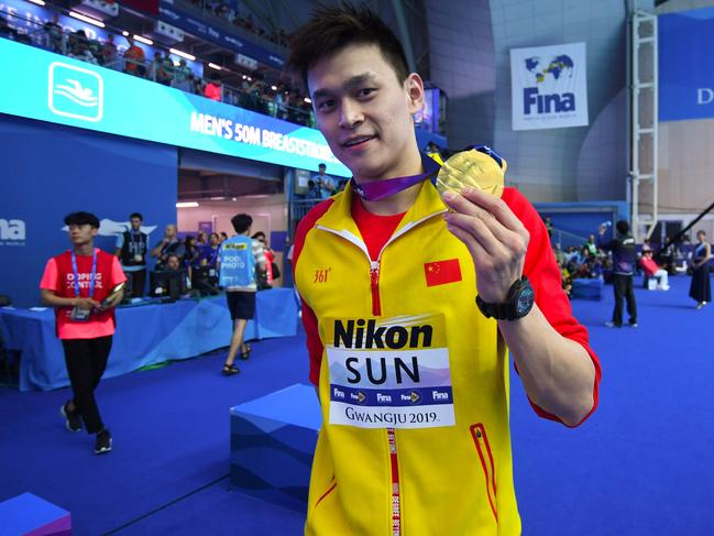 Sun Yang poses with his gold medal after the final of the men's 200m freestyle.