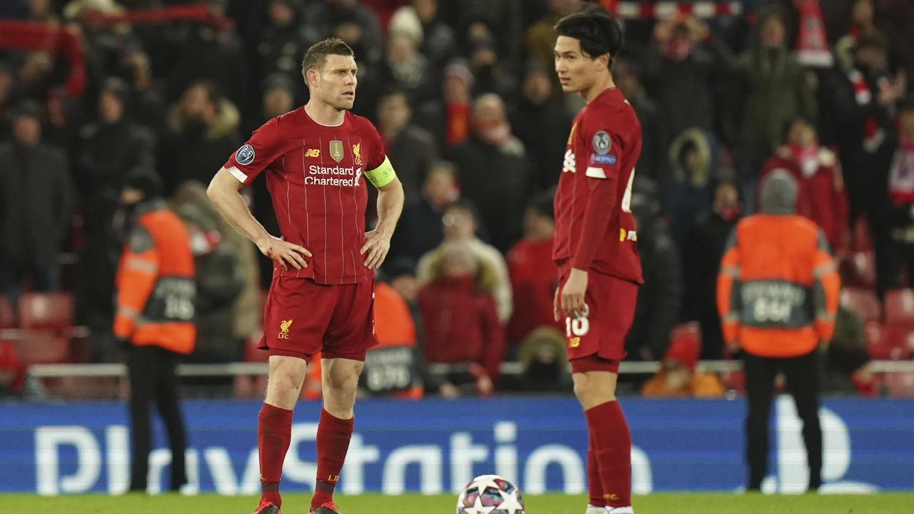 Liverpool's James Milner and Takumi Minamino will have to wait before their team can claim the title. Picture: Jon Super