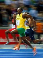 f4dfd91f4be ... a new 100m World Record after the final.  p Usain Bolt of Jamaica (R)  sprints to the finish to win