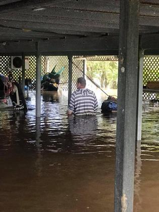 Cyclone Nora: Cairns family loses car as floodwaters reach ' level on