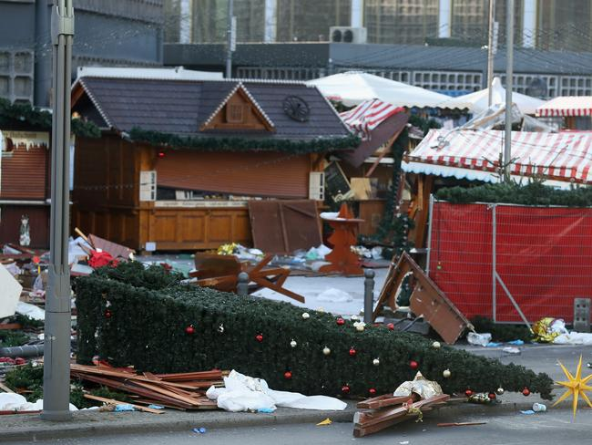The wrecked remains of the Christmas market stand where a man drove a heavy truck into the market in an apparent terrorist attack. Picture: Sean Gallup/Getty Images
