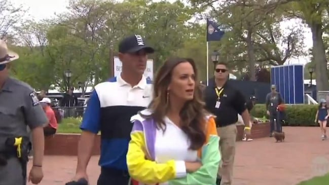 Not happy Jen: Brooks Koepka's partner fold her arms after being custard pied.