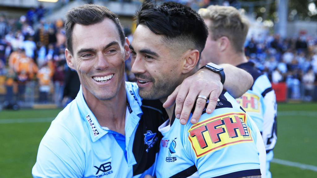 Sharks coach John Morris hugs Shaun Johnson of the Sharks after the pair qualified for the NRL finals with a win over the Wests Tigers. Picture: Mark Evans/AAP