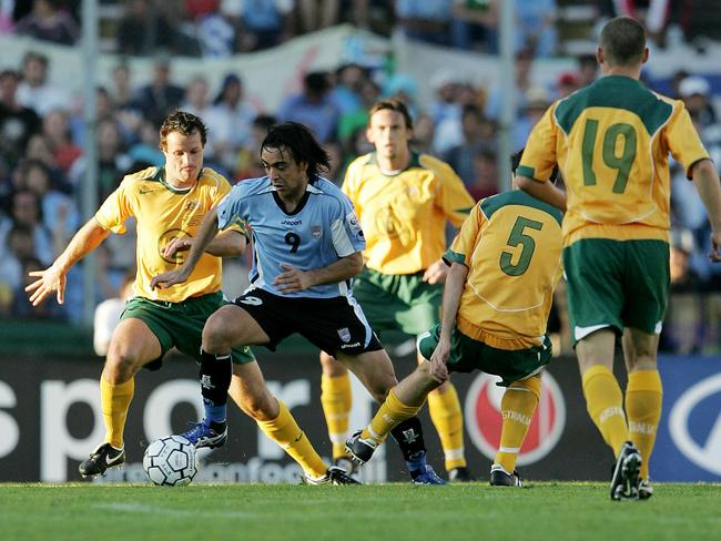 Alvaro Recoba gets through Sooceroos defence of Lucas Neill, Tony Popovic, Tony Vidmar and Jason Culina during the first leg in the 2005 World Cup play-off.