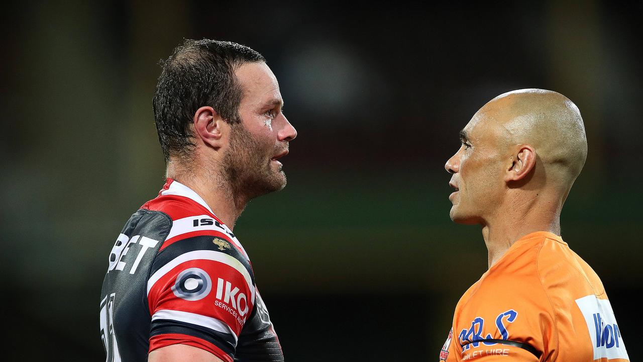 Roosters' Boyd Cordner in the hands of the trainer during the NRL match between the Sydney Roosters and Newcastle Knights at the SCG. Picture. Phil Hillyard