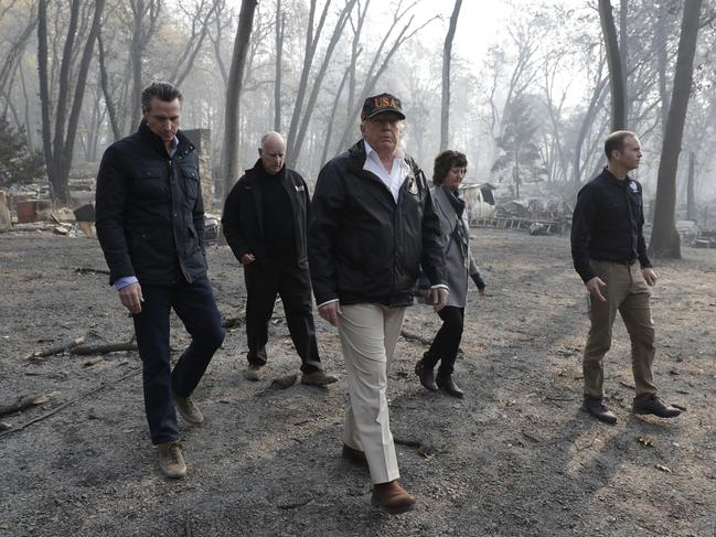 President Donald Trump tours Paradise with Gov.-elect Gavin Newsom, California Gov. Jerry Brown, Paradise Mayor Jody Jones and FEMA Administrator Brock Long, right, during a visit to a neighborhood impacted by the wildfires. Picture: AP