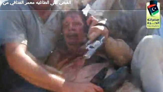 One Libyan fighter claimed Gaddafi was shot in the lower body with a 9mm gun. Picture: Supplied