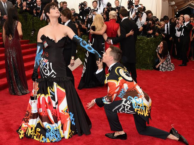 Kiss, kiss ... Katy Perry and designer Jeremy Scott at the Metropolitan Museum of Art. Picture: Larry Busacca/Getty Images