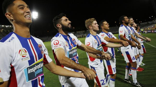Newcastle Jets players thank their travelling fans.