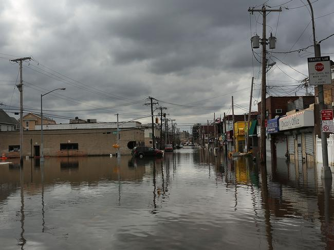 Flood damaged streets are viewed in the Rockaway section of Queens where the historic boardwalk was washed away due to Hurricane Sandy on October 31, 2012 in the Queens borough of New York City. Picture: Spencer Platt/Getty Images/AFP